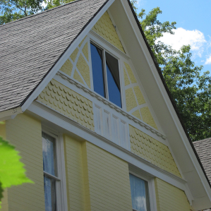 Yellow Scalloped Exterior Painting Restoration
