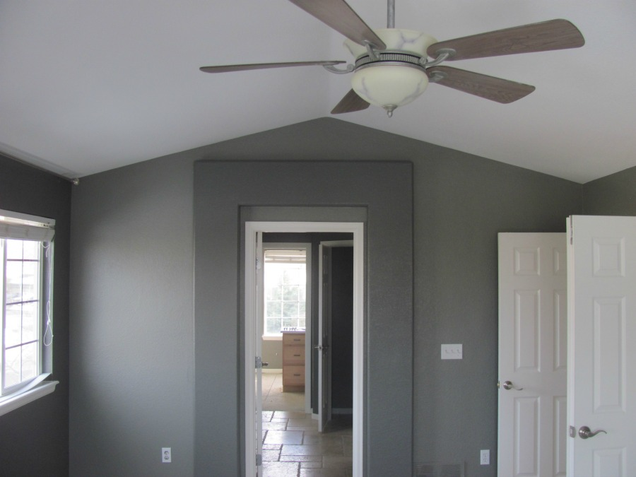 Interior painting gray walls with white accent. Popcorn ceiling removal.