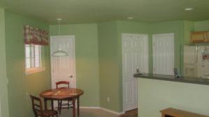 Interior painting green walls and looking sharp.