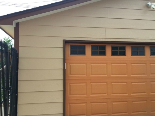 Brown, tan and burnt orange exterior home painting.