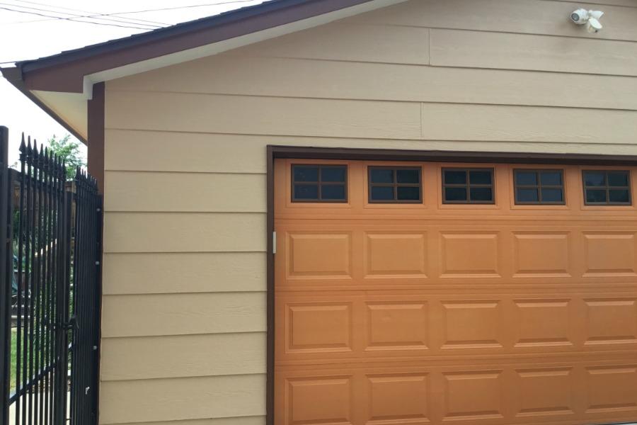 Brown, tan and burnt orange exterior home painting.