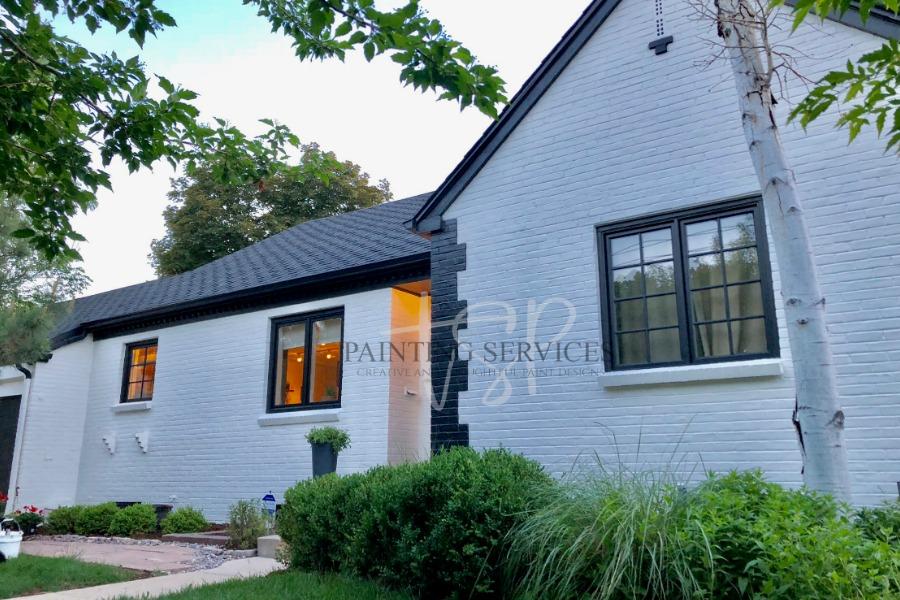 Two-toned brick exterior house with white bricks and black brick trim.