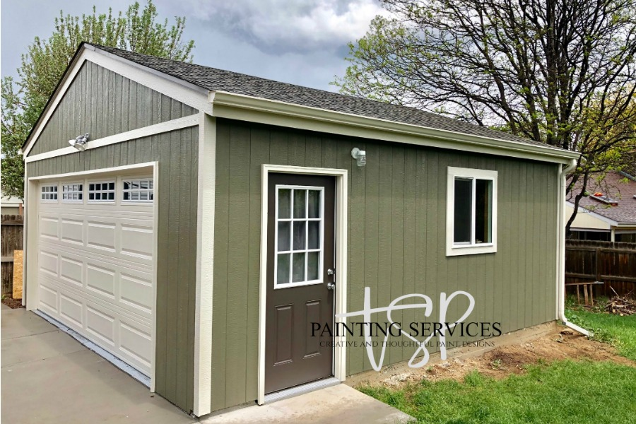Detached garage with freshly painted green exterior