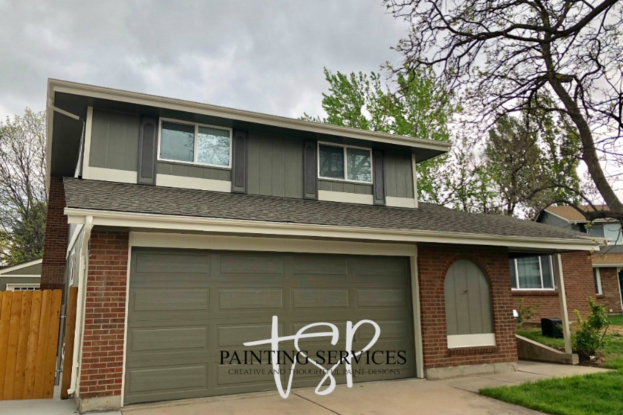 Two story exterior house and garage door repaint.