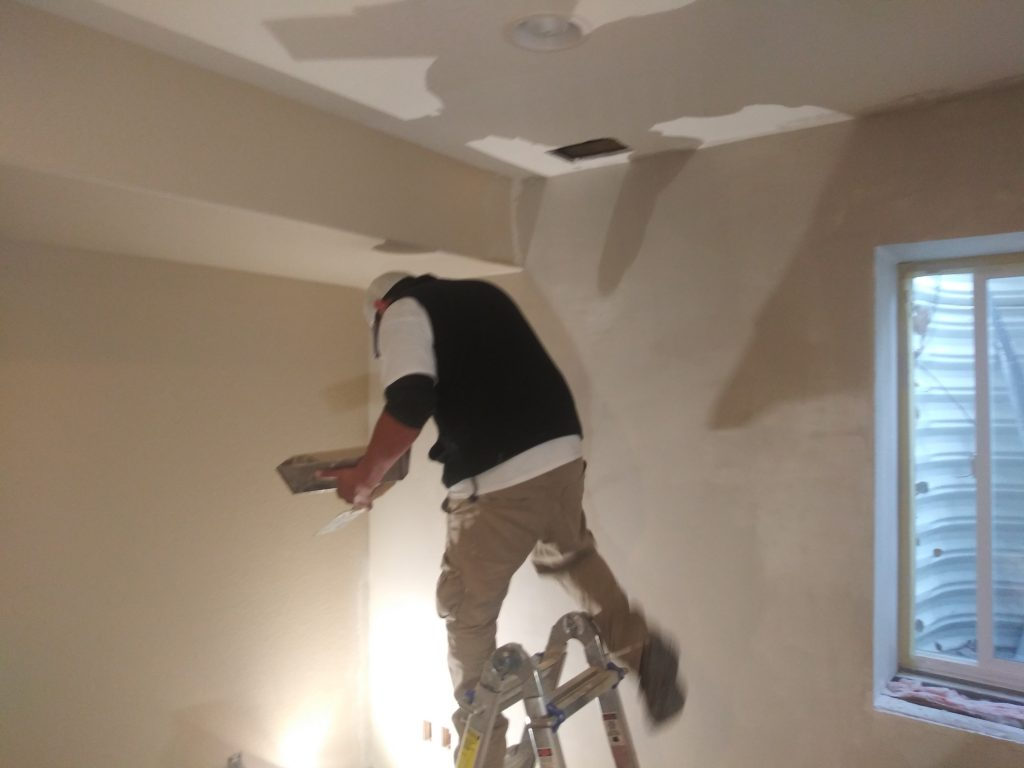 Drywall compound application.